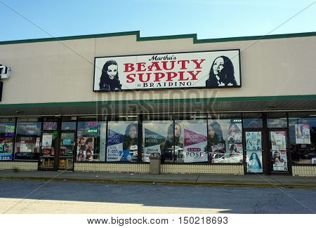 BOLINGBROOK, ILLINOIS / UNITED STATES - SEPTEMBER 17, 2016: One may purchase beauty supplies, and have one's hair cut and braided, at Martha's Beauty Supply and Braiding in Bolingbrook's River Woods Plaza strip mall.
