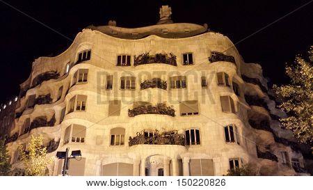 Barcelona, Spain - June 24, 2016: Illuminated facade of Casa Mila at night
