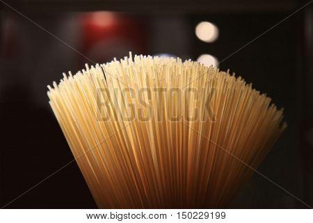 Yellow long spaghetti. Yellow italian pasta. Long spaghetti. Raw spaghetti bolognese.