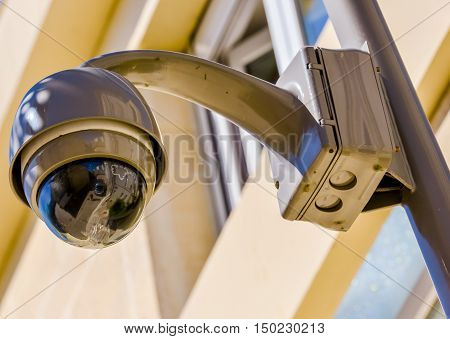 closeup on security CCTV camera or surveillance system in office building