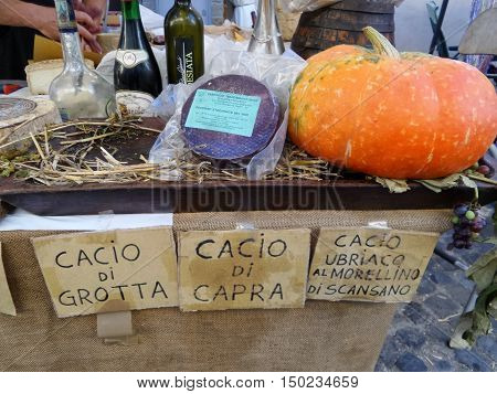 ORIOLO ROMANO, ITALY - SEPTEMBER 25 2016: Italian cheese wines schnapps and pumpkins in sale on stand with the occasion of Porcini Mushrooms Festival.