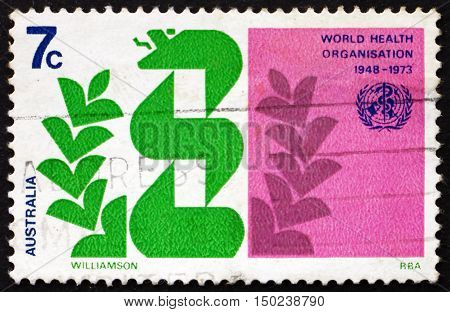 AUSTRALIA - CIRCA 1973: a stamp printed in Australia shows Stylized Caduceus and Laurel WHO 25th Anniversary circa 1973