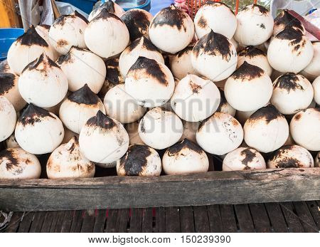 Fresh coconuts for sale in the market.