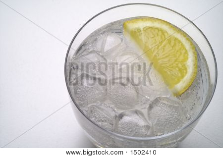 Glass Of Water (Or Liquor) With Ice And  Lemon Slice Closeup (1)