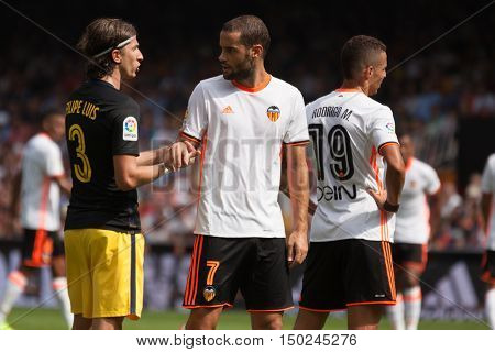 VALENCIA, SPAIN - OCTUBER 2nd: Filipe Luis and Suarez during Spanish soccer league match between Valencia CF and Atletico de Madrid at Mestalla Stadium on Octuber 2, 2016 in Valencia, Spain
