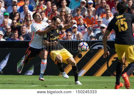 VALENCIA, SPAIN - OCTUBER 2nd: (L) Bakkali and JuanFran during Spanish soccer league match between Valencia CF and Atletico de Madrid at Mestalla Stadium on Octuber 2, 2016 in Valencia, Spain