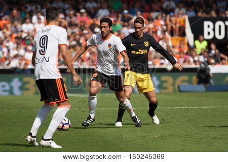 VALENCIA, SPAIN - OCTUBER 2nd: Parejo with ball and Torres during Spanish soccer league match between Valencia CF and Atletico de Madrid at Mestalla Stadium on Octuber 2, 2016 in Valencia, Spain