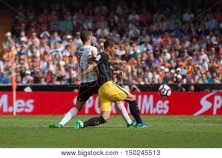 VALENCIA, SPAIN - OCTUBER 2nd: (L) Suarez (R) Lucas during Spanish soccer league match between Valencia CF and Atletico de Madrid at Mestalla Stadium on Octuber 2, 2016 in Valencia, Spain