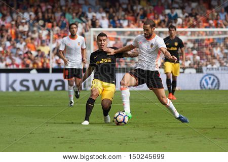 VALENCIA, SPAIN - OCTUBER 2nd: (L) Correa (R) Suarez during Spanish soccer league match between Valencia CF and Atletico de Madrid at Mestalla Stadium on Octuber 2, 2016 in Valencia, Spain