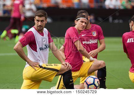 VALENCIA, SPAIN - OCTUBER 2nd: (L) Gabi during Spanish soccer league match between Valencia CF and Atletico de Madrid at Mestalla Stadium on Octuber 2, 2016 in Valencia, Spain