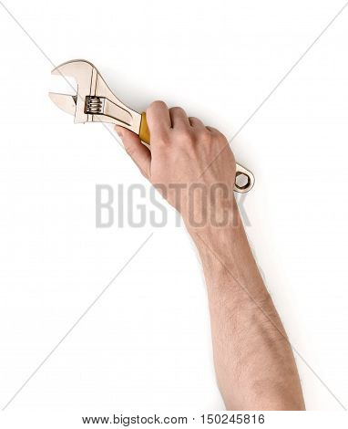 Close up view of a man's hand holding adjustable wrench isolated on white background. Mechanic and repairman. Handyman. DIY concept. Tools and instruments.