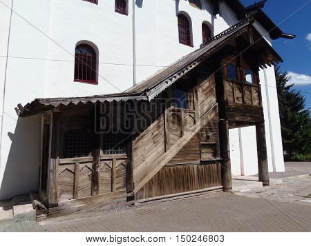 Russia Veliky Novgorod wooden extension to a white stone house with steps to the second floor