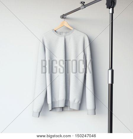 Gray Blank Sweatshirt On Modern Hanger. 3D Rendering
