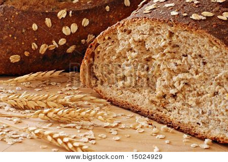 Freshly baked whole grain wheat bread with wheat spikes.  Macro with shallow dof.