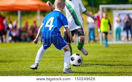 Children Playing Professional Football Match. Youth School Soccer League