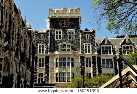 New York City - May 2 2015: Clock tower of neo-gothic Harris Hall at City College of New York on Convent Avenue in Hamilton Heights