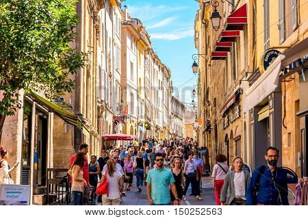 Aix-en-Provence, France - June 20, 2016: City street view with people walk in the old town of Aix-en-Provence on the south of France. This city is very popular among tourists