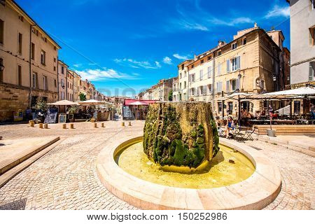 Aix-en-Provence, France - June 20, 2016: Cardeurs square with fountain in the old town of Aix-en-Provence city on the south of France.