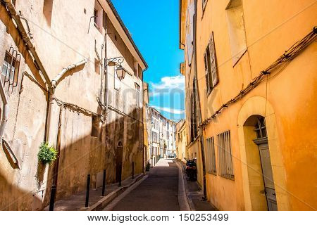 View on the narrow street in the old city center in Aix-en-Provence in France