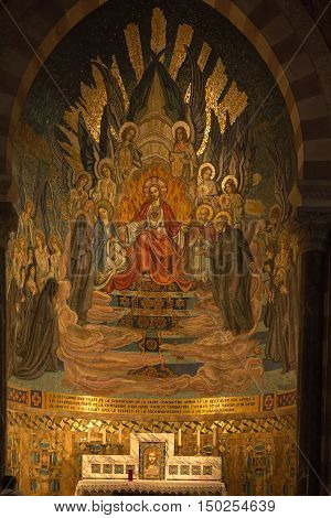 Paray Le Monial France - September 13 2016: Shrine of St. Claude de la Colombiere in Paray-le-Monial France mosaic behind the altar inside the church