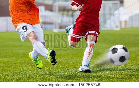 Soccer kick. Player kicking soccer ball. Football soccer tournament. Youth soccer