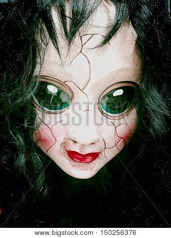 creepy scary doll with camera lens eyes