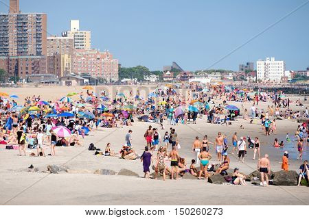NEW YORK,USA - AUGUST 18,2016 : People at the beach at Coney Island in New York City