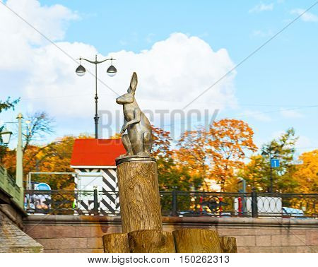 ST PETERSBURG RUSSIA-OCTOBER 3 2016.Monument The Hare Escaping Flooding on the pole near Peter and Paul fortress. It commemorates the hares that lived in large numbers on Hare Island in St Petersburg