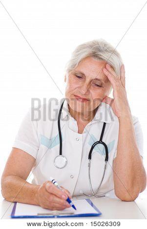 Elderly Doctor Sitting