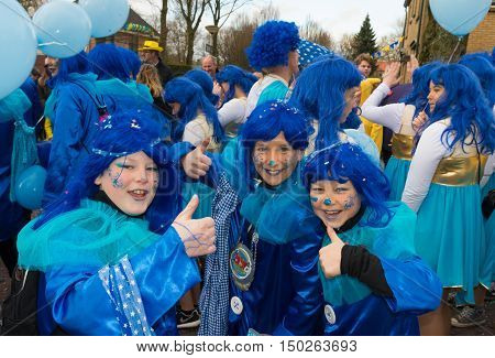 OLDENZAAL NETHERLANDS - FEBRUARY 7 2016: Unknown children with blue hairpieces joining the annual carnival parade