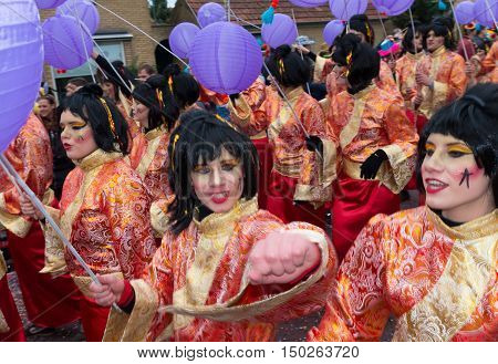 OLDENZAAL NETHERLANDS - FEBRUARY 7 2016: Unknown people in funny carnival dresses during the annual carnival parade