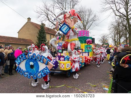 OLDENZAAL NETHERLANDS - FEBRUARY 7 2016: Unknown people joining the annual carnival parade with a decorated wagon