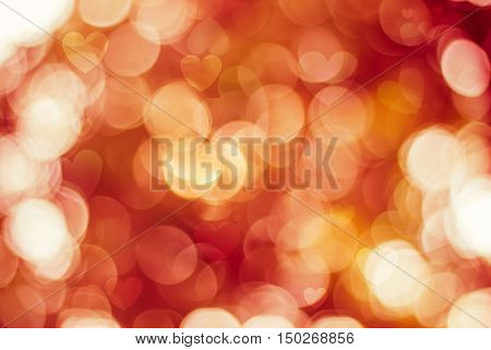 Blurred background of Valentine's day concept. Valentines Day Card. Pastel color tones.Orange white hearts .