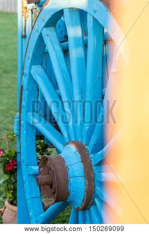 vintage blue wooden wagon used as a decorative object. Closeup