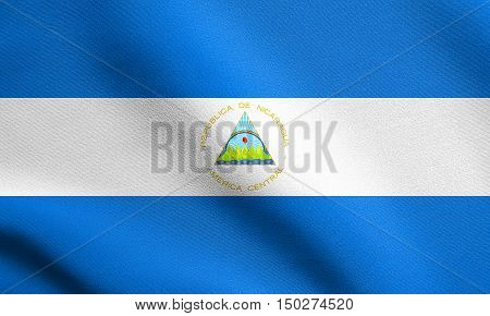 Nicaraguan national official flag. Patriotic symbol banner element background. Accurate dimensions. Correct size colors. Flag of Nicaragua waving in the wind with detailed fabric texture, 3d illustration