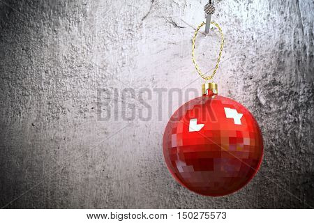 red shiny christmas bauble hanging on the nail on old dirty rough wall, 3d rendering