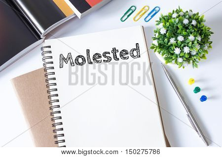 molested word message on white paper book and copy space on white desk / business concept / top view