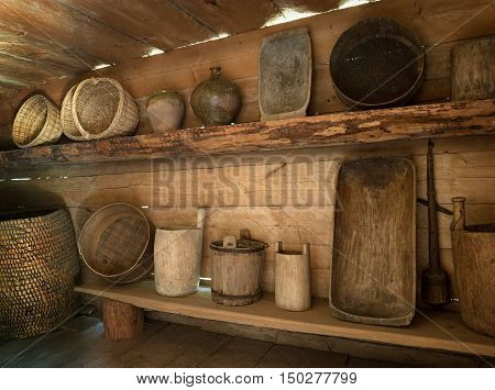 Handmade Old Dishes On The Shelf