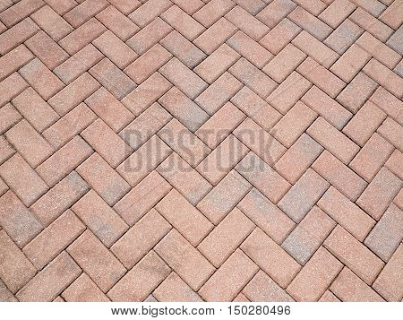 a herrigbone pattern created by bricks or pavers