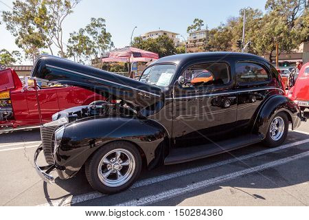 Laguna Beach, CA, USA - October 2, 2016: Black 1940 Ford Deluxe Sedan owned by Rob Stinson and displayed at the Rotary Club of Laguna Beach 2016 Classic Car Show. Editorial use.