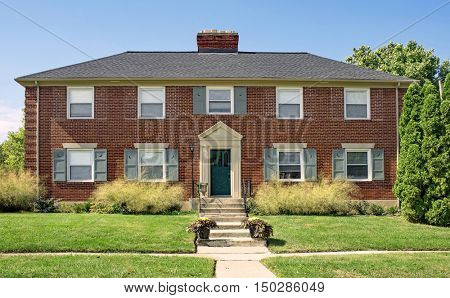 Red Brick Building with Ornamental Grasses