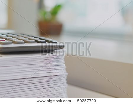 Pile Of Printout And Calculator