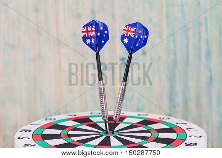 Darts arrow with Australia flags on red dart board