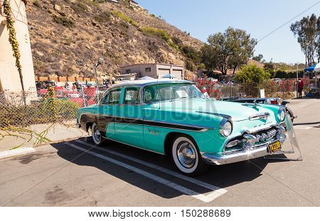 Laguna Beach, CA, USA - October 2, 2016: Blue 1955 DeSoto Coronado owned by Gerald Gaughen and displayed at the Rotary Club of Laguna Beach 2016 Classic Car Show. Editorial use.