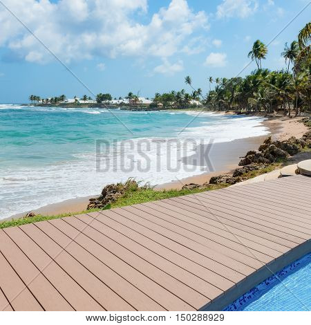 Tropical beach Tobago Caribbean nearby pool and wooden deck square