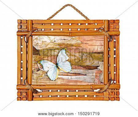 Bamboo photo frame with abstract composition of butterflies, birch bark and straw isolated on white background.