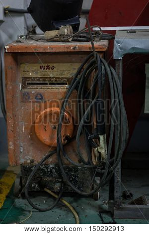 the dirty and old electric arc welding machine.