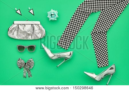 Fashion woman Clothes Accessories Set. Fashion Design.Essentials fashion. Party Silver Outfit.Stylish Leggings, Glamor fashion Heels, Handbag Clutch Trendy Sunglasses, Rose.Top view. Creative.Minimal