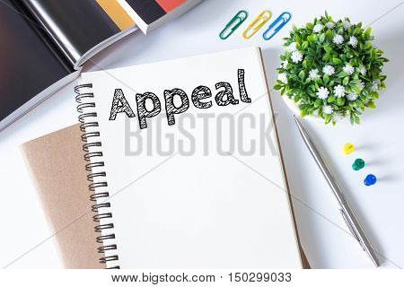 appeal message text on white paper book on white desk / business concept / top view