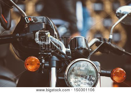 close-up of vintage moto with helmet on mirror bar